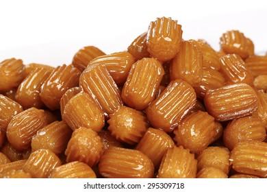 Turkish tulumba sweet or Turkish dougnhuts isolated on white background.