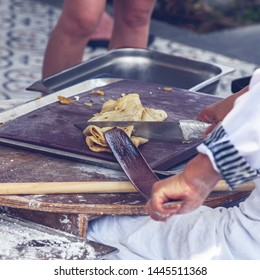 Turkish woman makes a traditional national dish - a baked flat pancake Gozleme.
