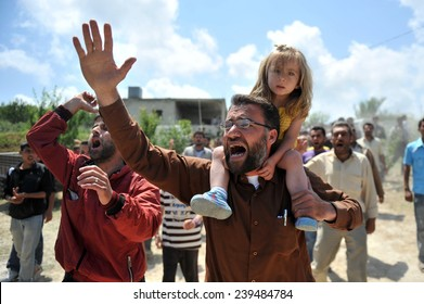 TURKISH-SYRIAN BORDER -JUNE 11, 2011: unidentified Syrian refugees, protested at the syria border   June 11, 2011 on the Turkish - Syrian border.