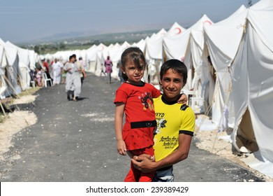 TURKISH-SYRIAN BORDER -JUNE 18, 2011: unidentified Syrian people in refugee camp in Turkey on June 18, 2011 on the Turkish - Syrian border.