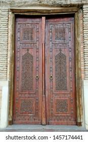 Turkistan, Kazakhstan – April 3, 2019 – Carved wooden door of the Mausoleum of Khoja Ahmed Yasawi in Turkistan