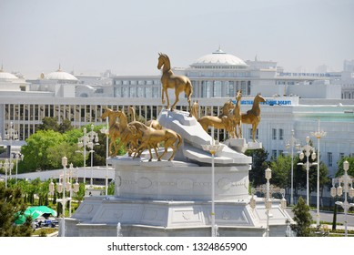 TURKMENISTAN, ASHGABAT - April 29, 2015: Akhal Teke horse monument and view of the city. Shot from the back.