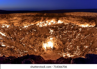 Turkmenistan gates of hell gas crater fire in Karakum desert near Darvaza. Burning methane gas crater in Derweze in Karakum desert. Door to hell in Turkmenistan.