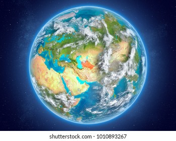 Turkmenistan in red on model of planet Earth with clouds and atmosphere in space. 3D illustration. Elements of this image furnished by NASA.