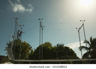 Turks and Caicos - December 2, 2014:  Several people training on trapeze