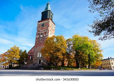 Turku Cathedral, is the Mother Church of the Evangelical Lutheran Church of Finland. It is also regarded as one of the major records of Finnish architectural history. Colorful autumn and blue sky.