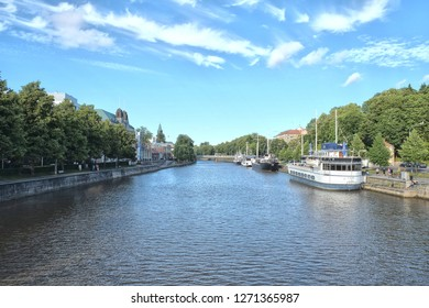 Turku, Finland - 08.03.2015: Turku is a city on the southwest coast of Finland at the mouth of the Aura River, in the region of Southwest Finland. River with boats