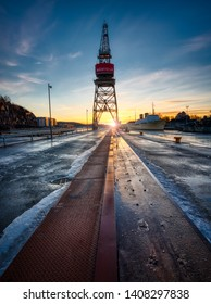 Turku, Finland - 17/02/2017: Old crane and golden sunset in Turku, Finland