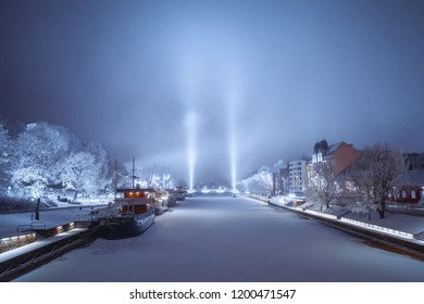 TURKU, FINLAND - 20/01/2018: Teatterisilta bridge illuminated by lights during foggy night in Turku, Finland