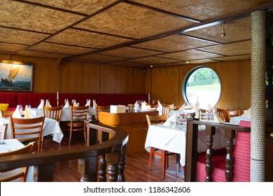Turku, Finland - 22 September 2018: Interior of SVARTE RUDOLF boat restaurant in Turku