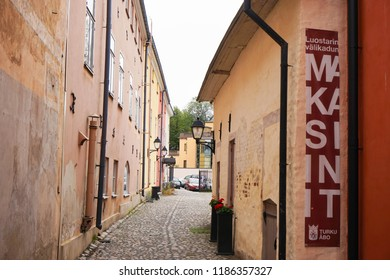 Turku, Finland - 22 September 2018: Luostarin välikatu, running through the Great Old Square, was Turku's artery in the Middle Ages and now served as a background for many films.