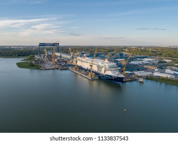 TURKU, FINLAND - 6/7/2018: Aerial view of Meyer Turku shipyard with Mein Schiff cruise ship under construction