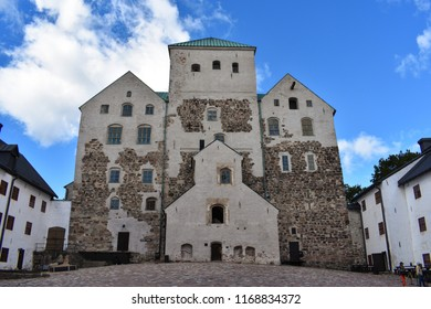 Turku, Finland - August 6 2018: Turku Castle stands tall and strong. This is the entrance to the castle itself facing its courtyard.