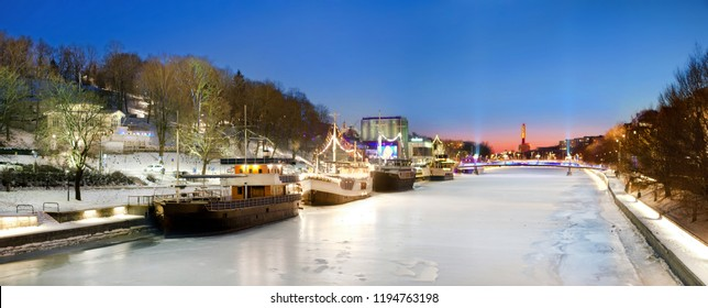 Turku, Finland. Beautiful view of  frozen, iced Aura river at clear winter night with boats. Panorama picture. Aura river is popular tourist destination in Turku. Night shoot.