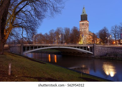 TURKU, FINLAND - DECEMBER 25, 2016: View to the Turku Cathedral and the river Aura. It is the central church of the Archdiocese of Turku and the seat of the Archbishop of Finland