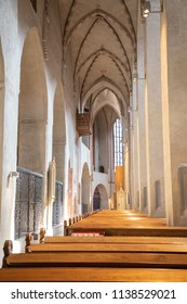 Turku / Finland - June 24 2018:  Left (north) side of the nave, viewing pews and high arched ceiling, looking in the direction of the chancel, in Turku Cathedral, in Turku, Finland, during midsummer.