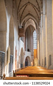 Turku / Finland - June 24 2018:  Left (north) side of the nave, with pews and high arched ceiling, looking in the direction of the chancel, in Turku Cathedral, in Turku, Finland, during midsummer.