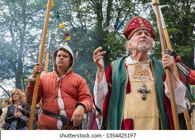 Turku, Finland - June 30, 2018: Actors perform as religious figures during the Medieval Turku (Reskiajan Turku) festival in colorful period costumes.