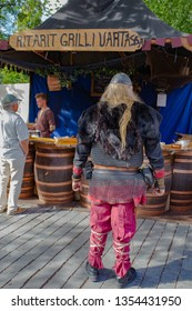 Turku, Finland - June 30, 2018: Actors and artisans participate in the Medieval Turku (Reskiajan Turku) festival in colorful period costumes.