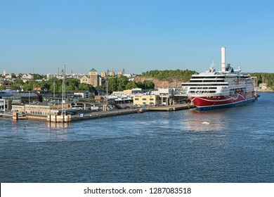 TURKU, FINLAND - MAY 31, 2018: Port of Turku close to Turku Castle. MS Grace is berthed at the passenger terminal of Viking Line. The ship was built in 2013. The castle was founded in the 13th century