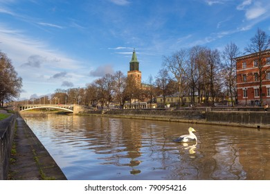 TURKU, FINLAND- November 02, 2013: View of the  Turku Cathedral and the Aura river. Turku Cathedral is the Mother Church of the Evangelical Lutheran Church of Finland.