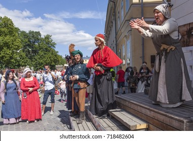 TURKU, FINLAND ON JUNE 30. Performance, street theater, acting during the Medieval Market and Festival on June 30, 2017 in Turku, Finland. Unidentified people in the street.