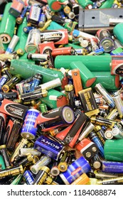 TURKU, FINLAND - September 19, 2018: Many used batteries and accumulators. Vertical image.
