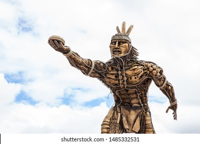 TURMEQUE, COLOMBIA – AUGUST, 2019: Monument to Chaquen the god of sports and fertility in the religion of the Muiscas indigenous playing the national Colombian game called tejo