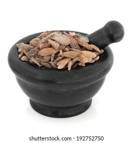 Turmeric curcuma root chinese herbal medicine in a black stone mortar with pestle over white background. Yu jin.