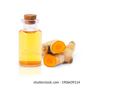 Turmeric essential oil with Tumeric ( curcumin, Curcuma longa Linn ) root isolated on white background.