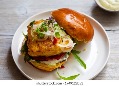 Turmeric fish burger in brioche bun