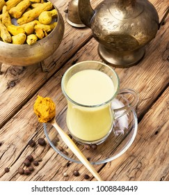 Turmeric Golden milk in a glass cup