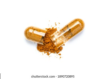 Turmeric herbal powder capsules isolated on white background. Top view. Flat lay.