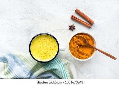 Turmeric latte, Cooking Golden Milk On Kitchen. Hot healthy drink. Concrete background. Top view.