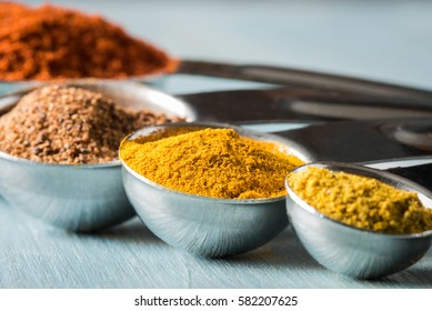 turmeric with other spices in measuring spoons