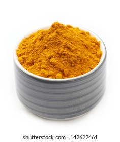 Turmeric Powder in a ceramic Bowl isolated on a white background.