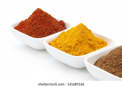 Turmeric Powder & Chili Powder in a Bowl isolated on White.