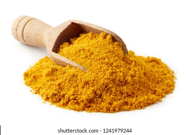 Turmeric powder (Curcuma), also known as Indian saffron, in wooden scoop isolated on white background