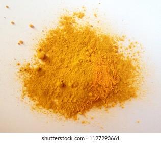 Turmeric powder ground isolated on white