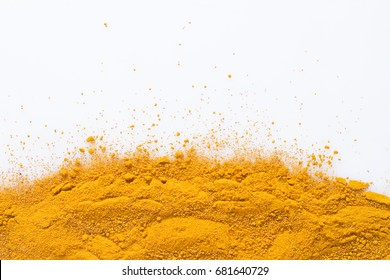 Turmeric powder isolated on white background