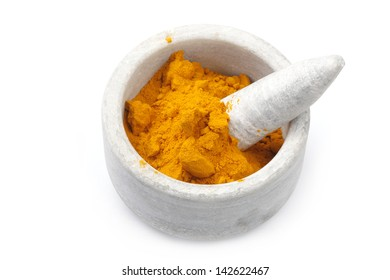 Turmeric Powder in a marble Bowl isolated on White.