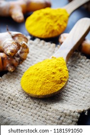 Turmeric with turmeric powder on wooden background.Spice Herbs concept.