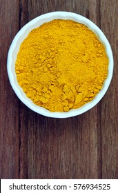 Turmeric powder over wooden background