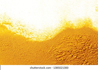 Turmeric powder pile isolated on white background and texture, top view