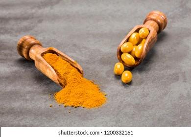 Turmeric powder and pills - Curcuma longa. Space for text