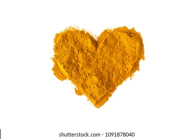 Turmeric powder in the shape of a heart. Isolated on white. Empty space for text or description.