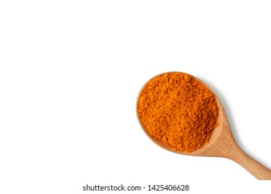 Turmeric powder (Tumeric curcumin, Curcuma longa Linn) in wooden spoon isolated on white background.Indian spice,healthy seasoning ingredient. Medicine herbal plant concept. Top view. Clipping path.