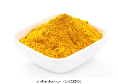 Turmeric Powder in a white square Bowl isolated on White background.