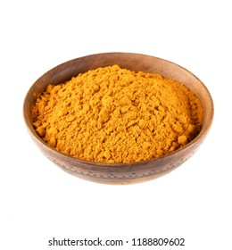 Turmeric powder in wooden bowl isolated on a white background