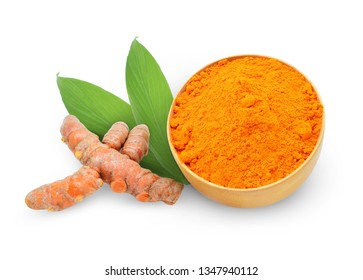 Turmeric powder in a wooden bowl with turmeric leaves and roots isolated on white background